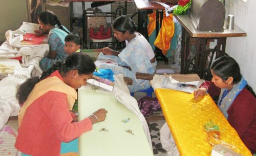 Women practice embroidery skills at a REDS Skills Training Center.