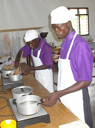 Young men learn culinary techniques at the MIRACLE skills training center.