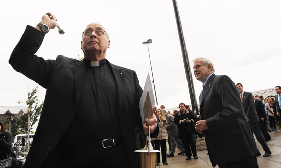 Bro. Raymond Fitz (right) watches as his brother, Fr. Jim Fitz, blesses the new Raymond L. Fitz Hall at the University of Dayton. Photo by Larry Burgess, UD