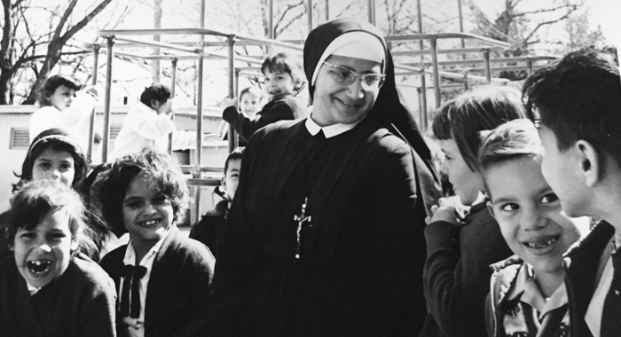 Sr. Estella Ibarra with first graders at St. James School in San Antonio in 1966. Sr. Estella currently serves in provincial administration for the Marianist Sisters.