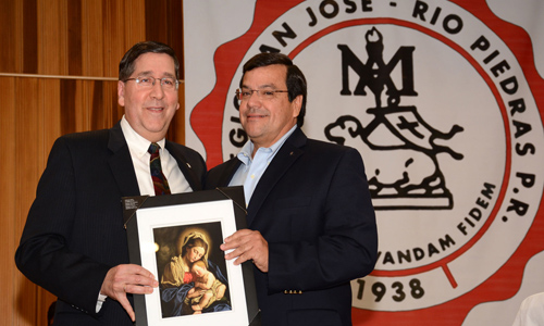 Bro. Francisco González receives a portrait of the Blessed Mother from Bro. Tom Giardino in recognition of Bro. Francisco's service to Colegio San José.