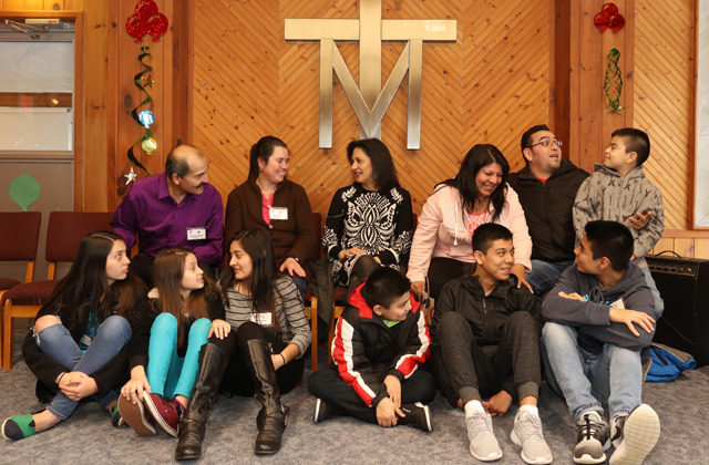 Members of the Lopez and Garcia families gather with retreat leader Catalina Shockey (center) at the Marianist Family Retreat Center.