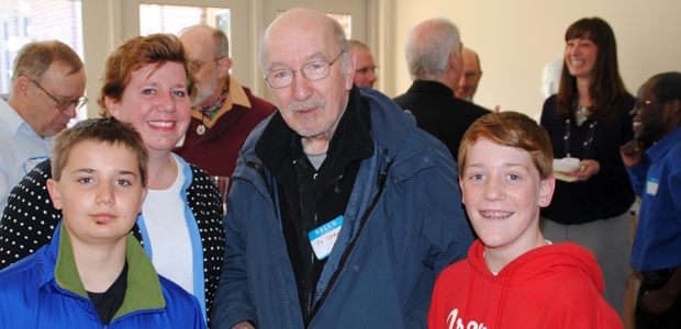 Laura Luehrmann-Burdick and sons Andrew (left) and Jakob joined Fr. Jerry Chinchar in celebrating the buidling dedication.
