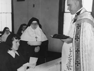 The Marianist Sisters first came to the United States in 1948. Marie Abmayr was the first U.S.-born sister. She is shown taking vows as a postulant in 1949. Fr. William Lamm, SM, received her vows. Today, Sr. Marie lives in Dayton.