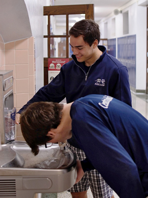 CCHS seniors Anthony Medellin and William Biediger demonstrate the simple methods of the school's #drinktap initiative.
