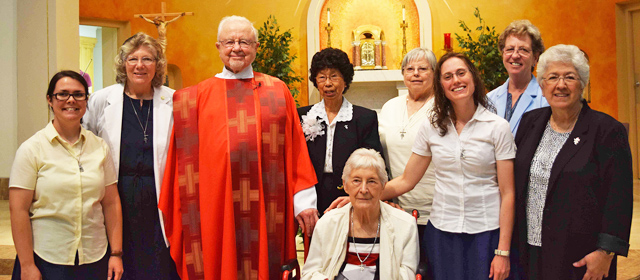 From left, Srs. Gabrielle Bibeau and Laura Leming, Fr. George Montague, Srs.  Stephanie Morales, Eileen Cehyra (seated), LaVon Kampf, Caitlin Cipolla-McCulloch, Grace Walle and Evangeline Escobar.