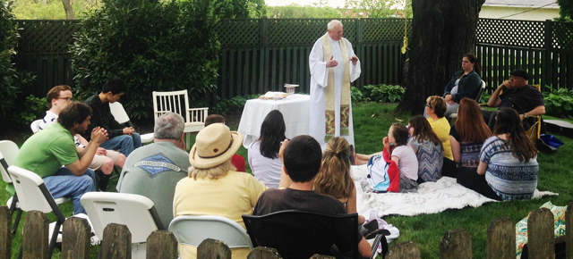 Fr. Pat Tonry celebrates an annual outdoor Mass with members of the Family Rosary Marianist Lay Community.