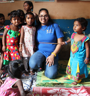 St. Mary's University student Priya Bhakta makes new friends at a Marianist REDS play school.