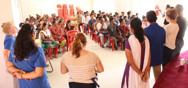Students from St.Mary's University discuss business skills with students of Marianist vocational programs in Bangalore.