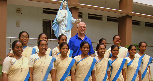 Bro. Steve Grazulis has spent many years serving in Eastern Africa. In July, however, he was in the District of India, where, among other endeavors, he provided a workshop for the Marianist Sisters pictured. We agree it looks like the Blessed Mother is about to pat him on the head!