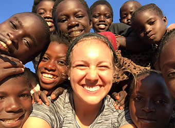 UD senior Abbey Saurine captures a many-smiled selfie with friends in Lubwe, Zambia.