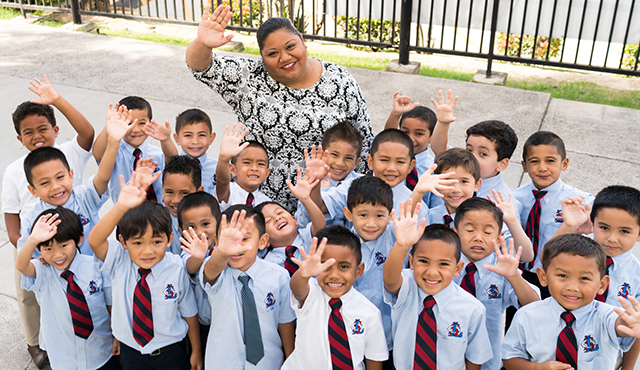 Kindergarten teacher Tasha Castro with her students at Saint Louis School in Honolulu.