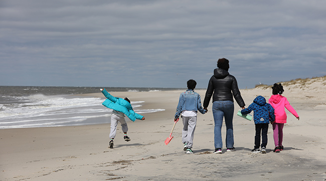 On the beach at the Marianist Family Retreat Center at Cape May Point, New Jersey, Jennifer Noriega and her children enjoy peaceful family time. The family was attending a retreat for the homeless.