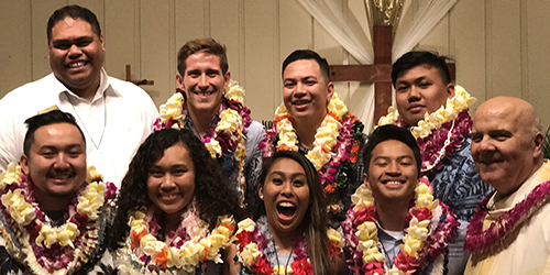 "Back: Bro. Brandon Alana (in charge of the formation process), Payton Sorg, Chris Kanamu and Andrew Inez.  Front: Andre ""Pono"" Riddle, Lyka Raza, Savannah Santos, Nicholas Fuller and Fr. George Cerniglia."
