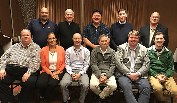 New members of the Marianist administrators community were welcomed at the meeting in October. In back are Andrew Farfsing, principal of Purcell Marian; Fr. Marty Solma, provincial; Tim Cullen, president of St. Anthony, Bro. Tom Giardino, assistant for education; and Tom Carone, president of St. Vincent-St. Mary. In front are Dan Donnelly, director of the Office of Sponsorship, Rana Boone, principal of St. Anthony; Ian Mulligan, principal of Vianney; Tim Readon, principal of Riordan; Andrew Currier, president of Riordan, Robert Brownfield, principal of St. Vincent-St. Mary.