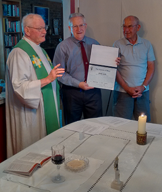 At a retreat in September, Fr. Al McMenamy welcomes the newest member of the North Tesa Affilate group, Phillip Keller. At right is the group's coordinator, Andy Gillard.